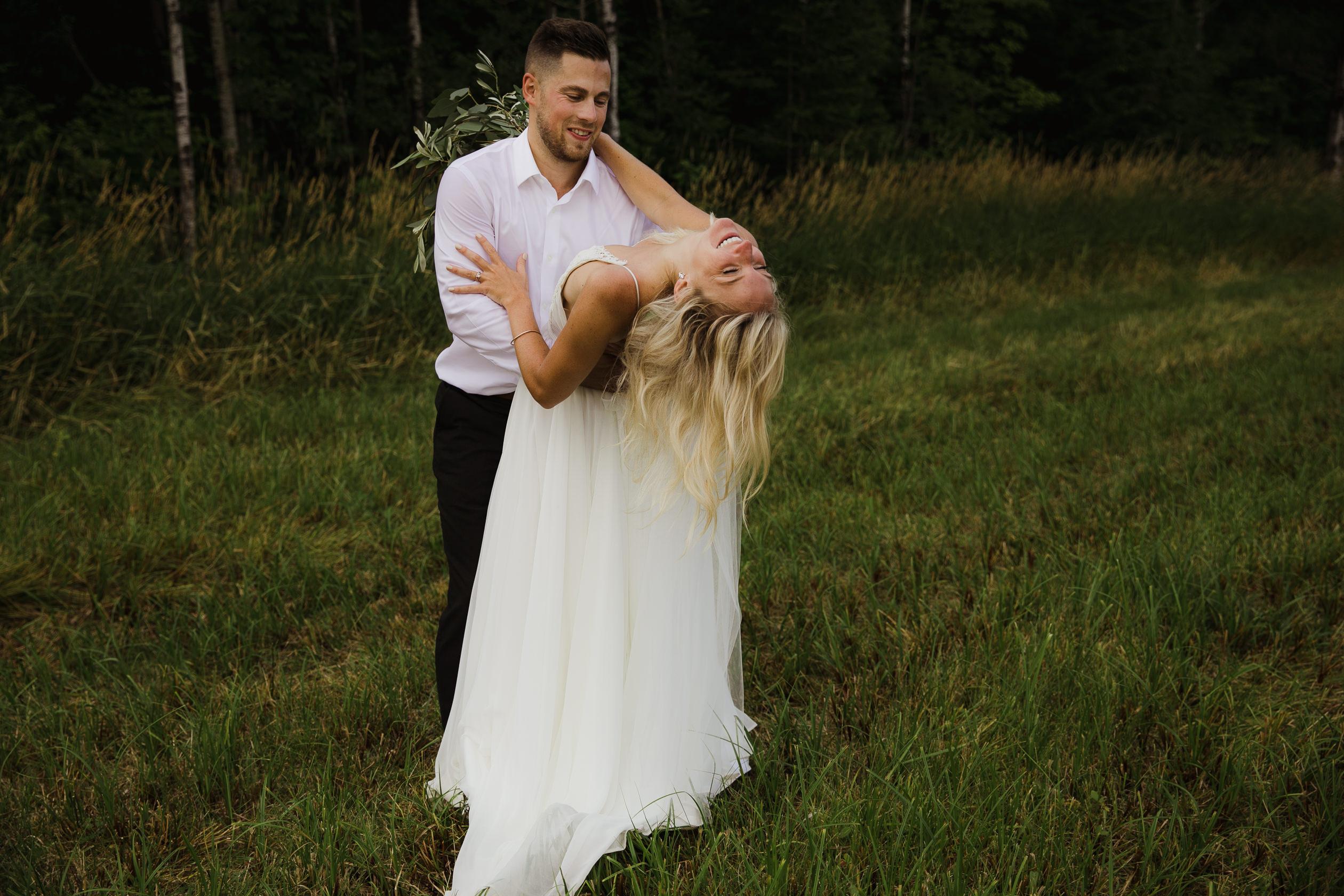 Wedding photo bride and groom portraits hair dress bouquet field summer