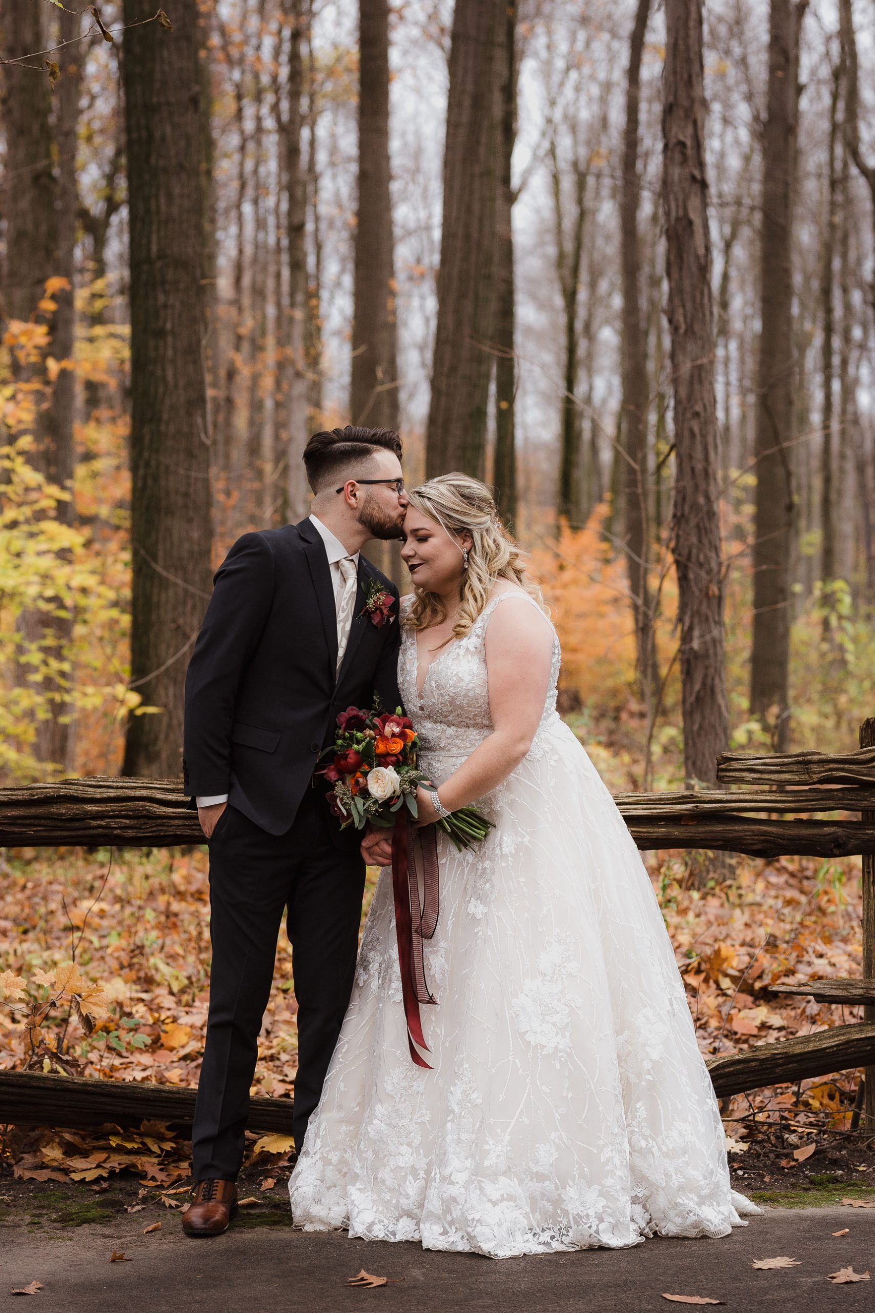 Wedding photo bride and groom portraits hair dress bouquet fall autumn colours leaves trees