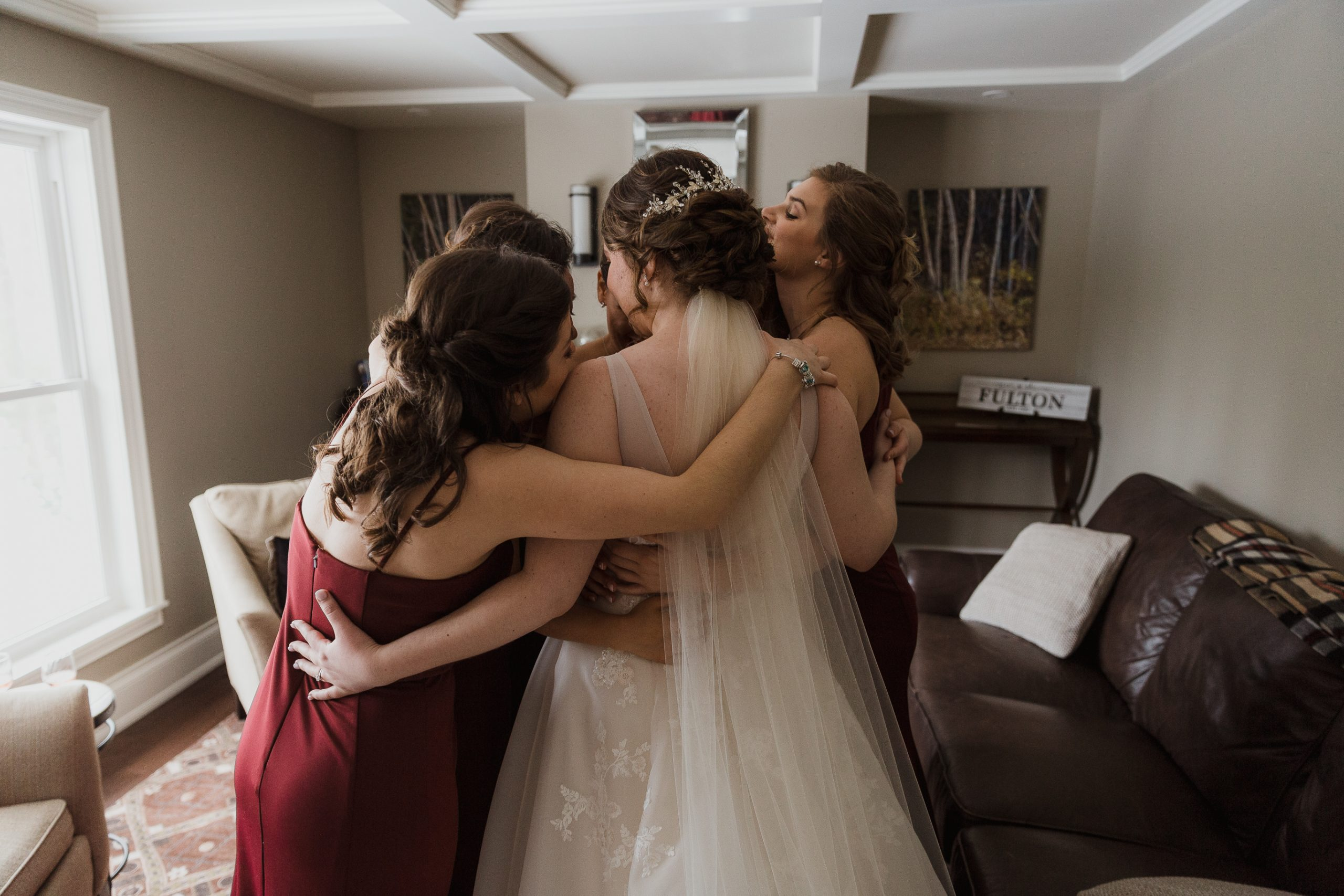Wedding photos girls getting ready special moment between bride and bridesmaids, hugging