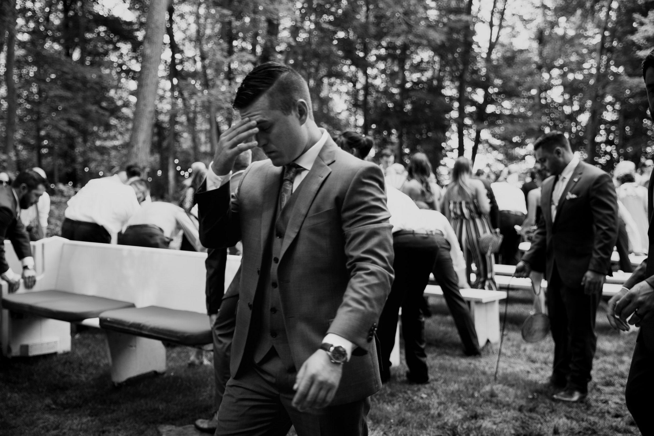 Wedding photo ceremony groom stressed from muddy ground outdoor