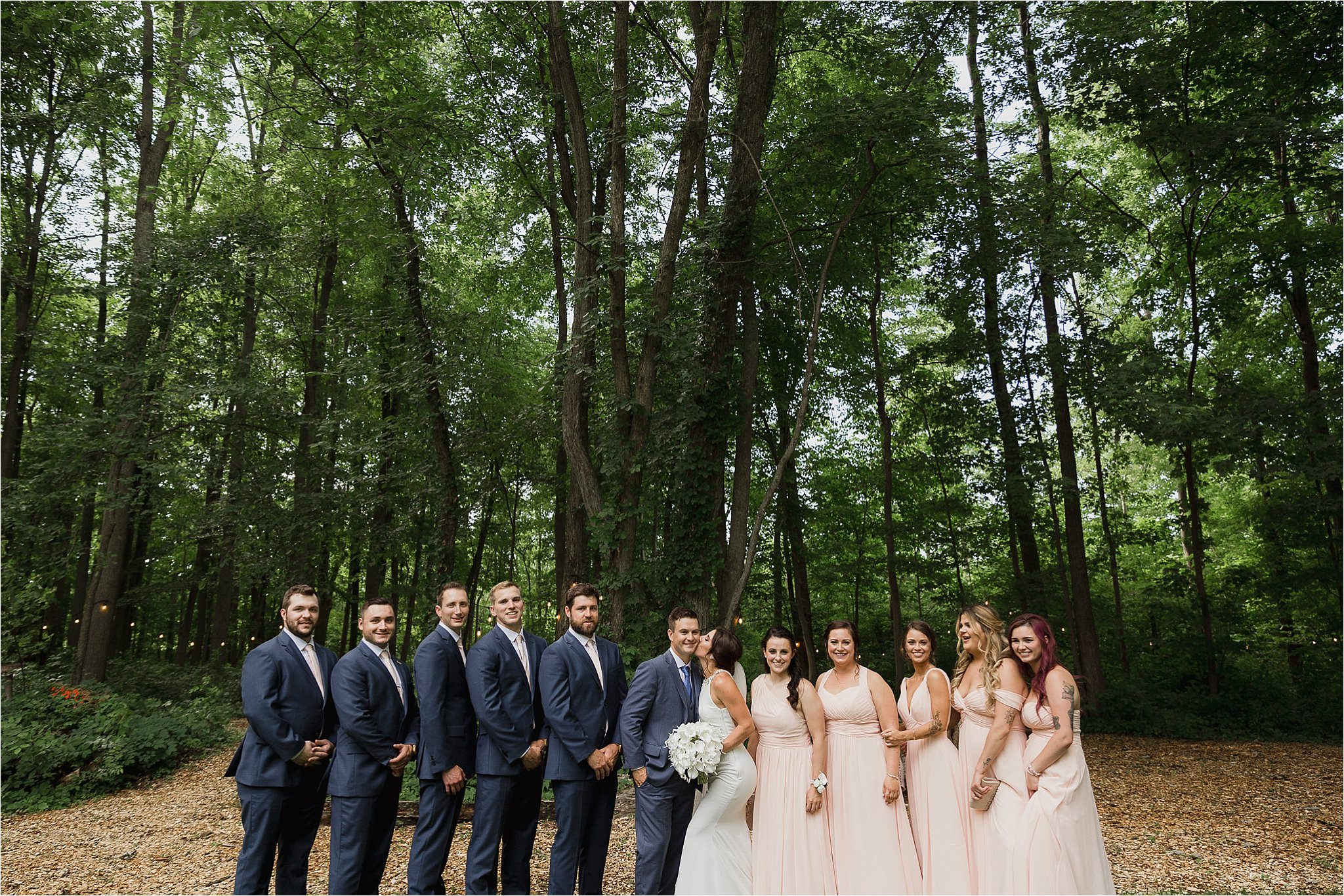 Sonia V Photography, The Clearing ceremony wedding venue, bridal party posing for a photo in the forest
