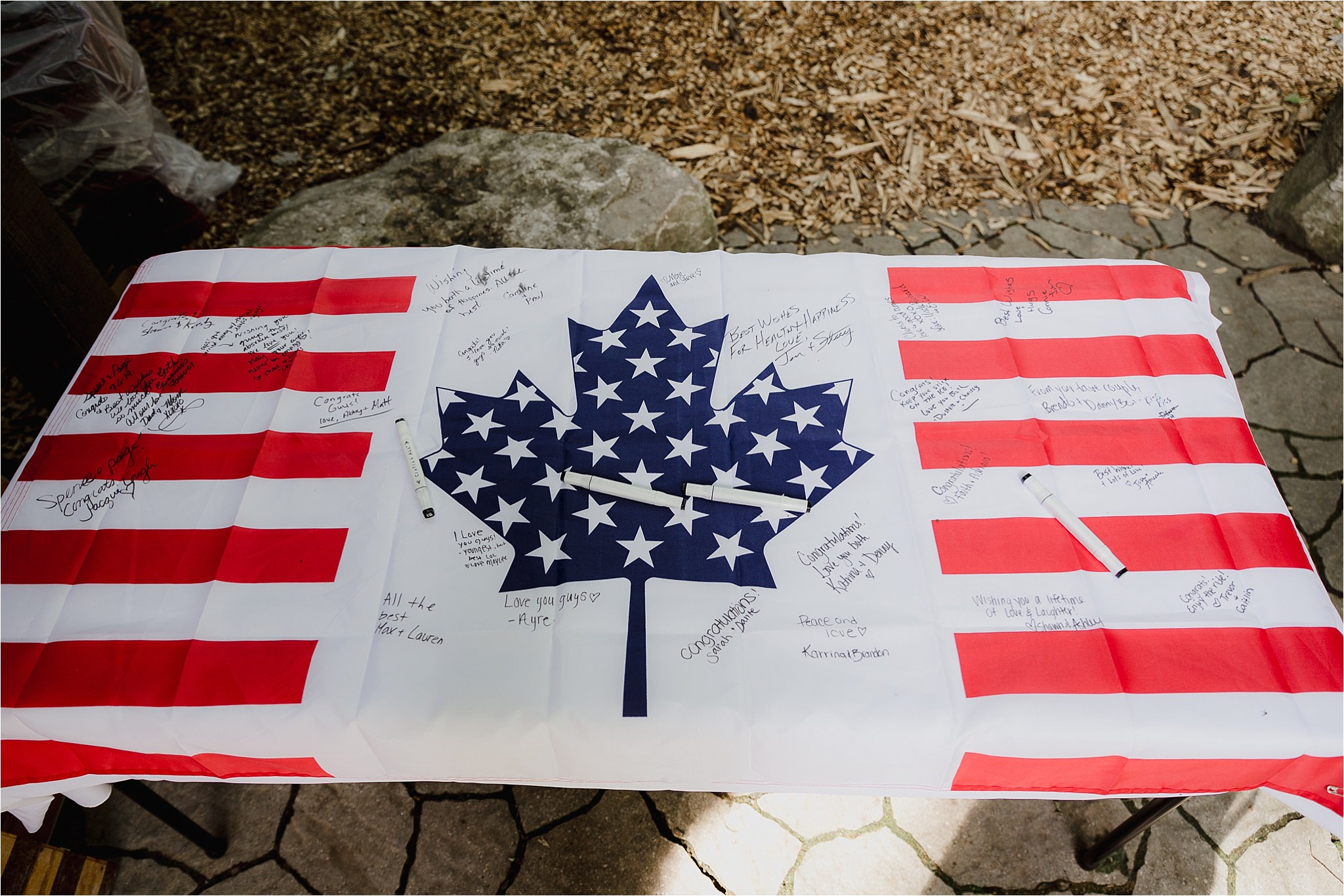 Sonia V Photography, The Clearing reception wedding venue, Canadian American flag guest book idea