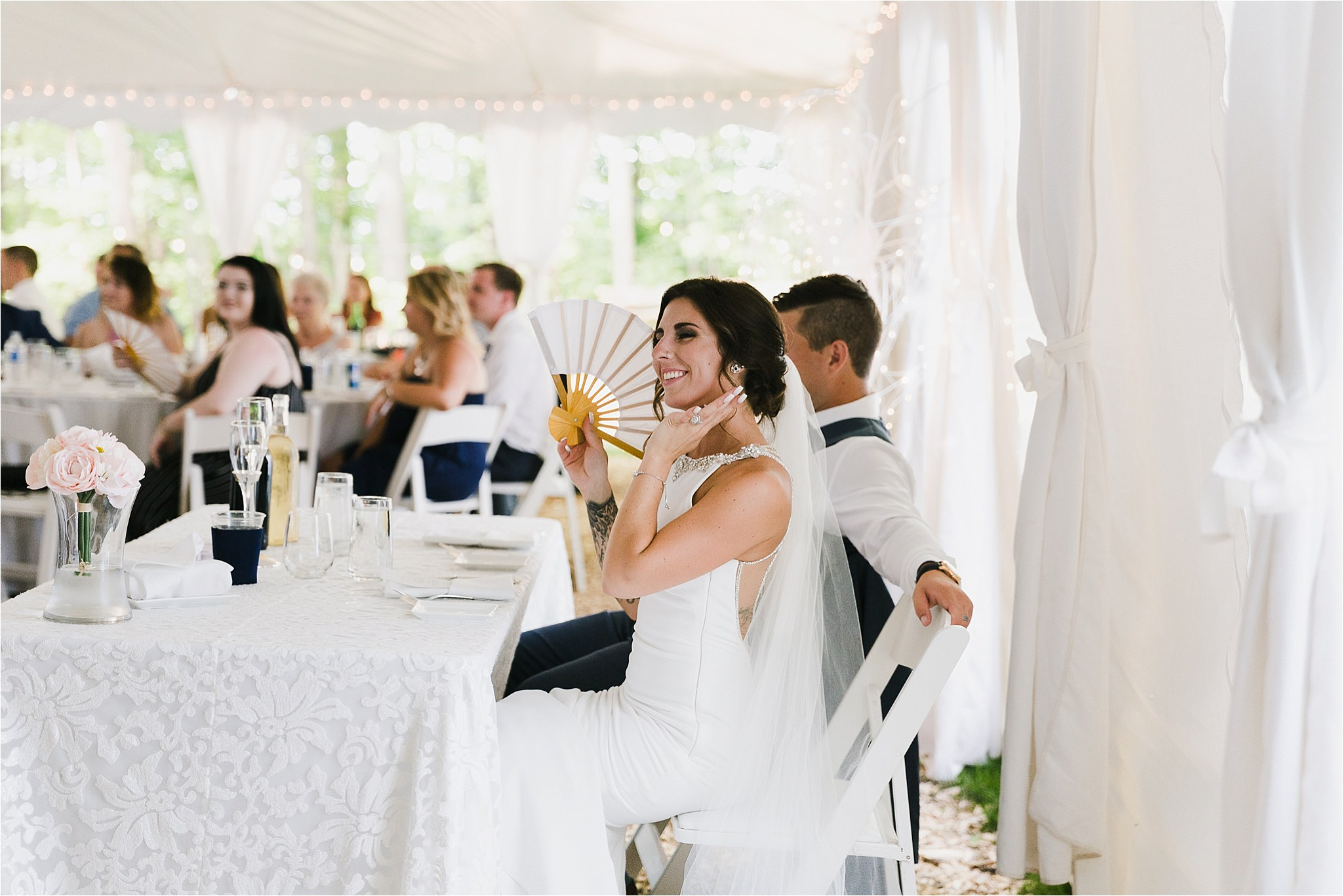 Sonia V Photography, The Clearing reception wedding venue, outdoor tent dinner, bride and groom seated at table