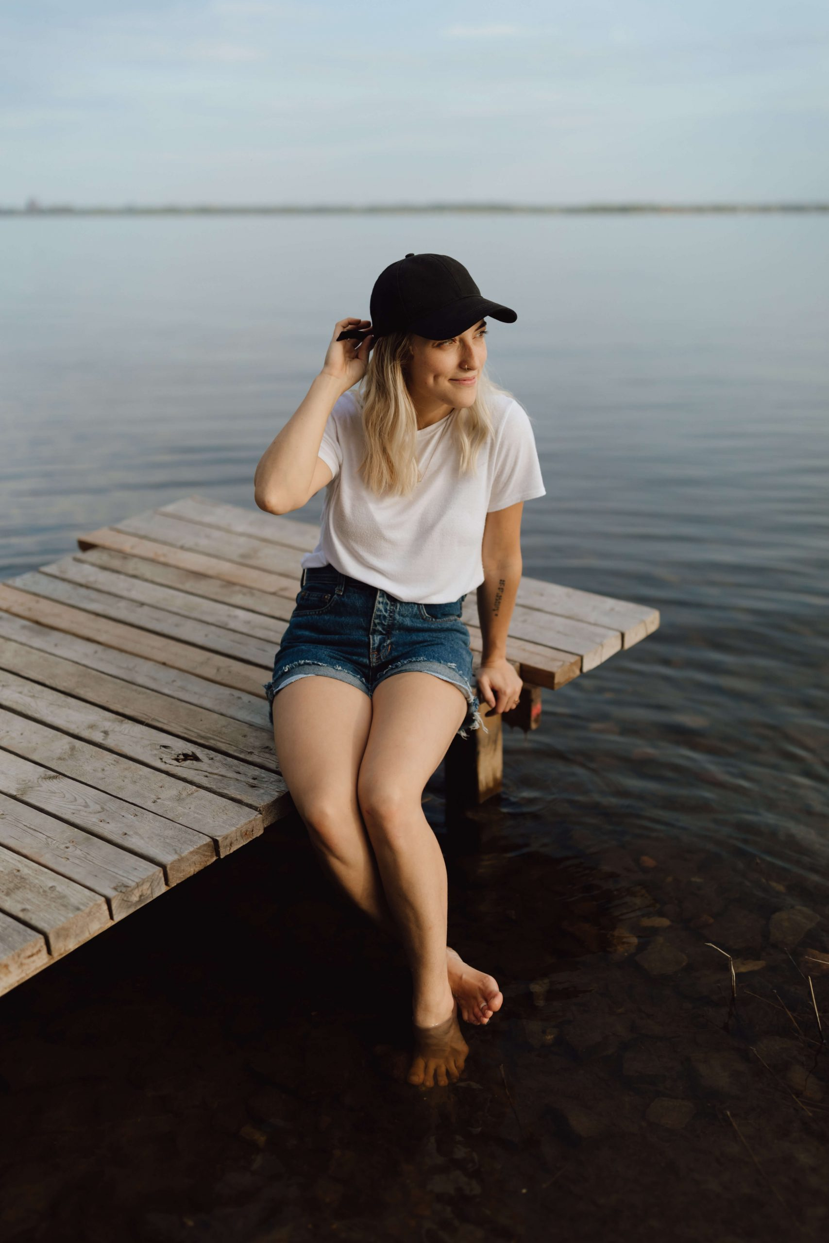Sonia on a dock on the river Sonia V Photo -Documentary Style Candid Photographer - Ottawa Ontario Kemptville Destination Photographer - Authentic Colour Photography - Wedding Photographer - Branding Photographer - Small Business Headshots - Engagement Photos - Family Portraits - Lifestyle
